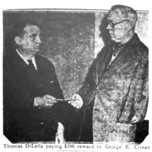 Thomas DiLella, Sr. paying George Crinan a reward for finding his son's body circa 1931